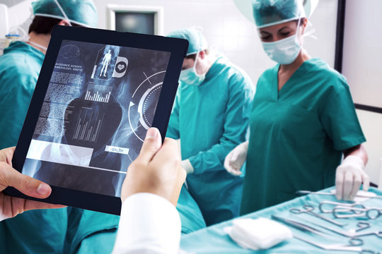 Man using tablet pc against medical interface on xray