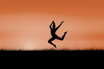 Fit brunette jumping and posing against sun rising