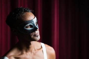 Man wearing masquerade mask