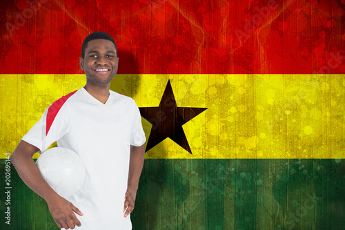 Grunge Camera Effect : Handsome football fan looking at camera against ghana flag in
