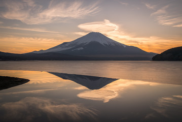 Mountain Fuji and Yamanakako ice lake with reflection in evening winter