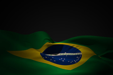 Papiers peints Brésil Brazil flag waving against black shadow
