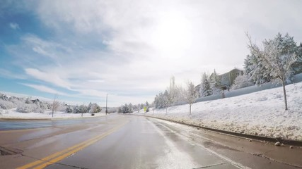 Wall Mural - Driving on suburban road after the Sping snow storm
