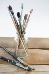 Various paintbrush in glass jar