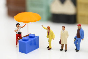 Miniature people : Shoppers with discount for shopping items of market street,Business Shopping concept.