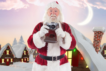Santa is taking a picture against cute christmas village under crescent moon