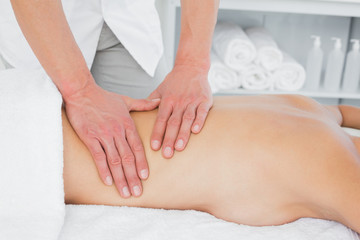 Closeup of a physiotherapist massaging womans back