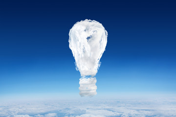 Cloud light bulb against blue sky over clouds at high altitude