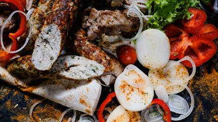 shish kebab shashlik. Meat and vegetables assortment background. National Caucasian cuisine. Delicious restaurant meal