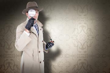Spy looking through magnifier against elegant patterned wallpaper in neutral tones