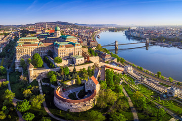 Keuken foto achterwand Boedapest Budapest, Hungary - Aerial panoramic skyline view of Buda Castle Royal Palace with Szechenyi Chain Bridge, Hungarian Parliament and Matthias Church at sunrise with clear blue sky