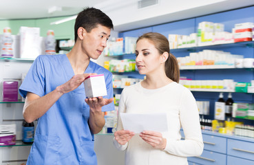 Adult client asking pharmacist about medicines