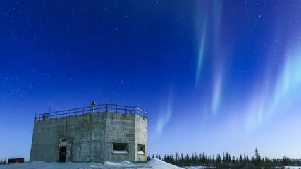 Wall Mural - Aurora Borealis Over Concrete Bunker Time-Lapse
