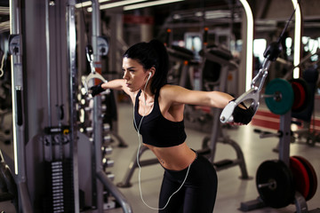 fitness woman execute exercise with exercise-machine Cable Crossover in gym