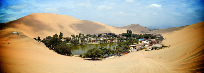 Sand dunes surround the Huacachina oasis, Ica, Peru