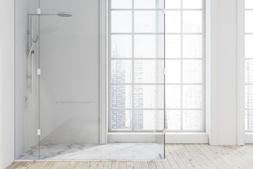 White bathroom with a shower stall
