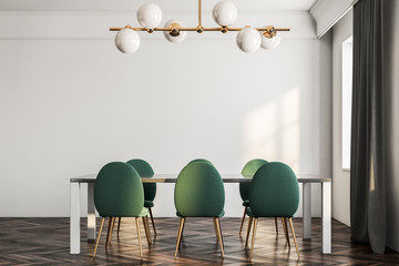 Minimalistic dining room interior, green chairs