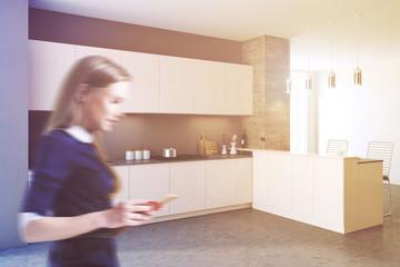Side view of a loft black kitchen blur