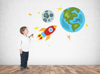 Adorable little boy drawing space travel
