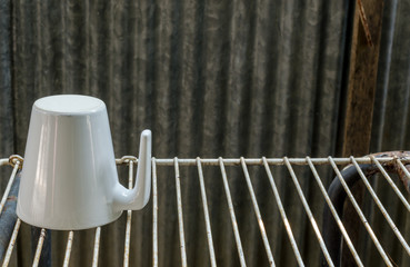 Coffee cup on the old background
