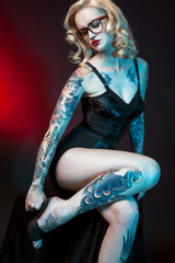 Beautiful girl with tattooed arms.,
