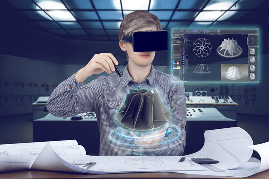 Futuristic cad engineer's workplace. Male / man wearing shirt and vr glasses touches with screwdriver 3d model of turbine and looking at virtual screen analyzing data for mechanic industry