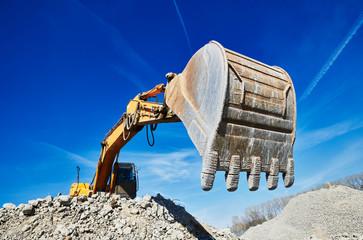 excavator loader machine at construction site