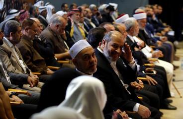Khalil al-Hayya, deputy head of Hamas in Gaza, gestures during the Palestinian National Popular Conference in Gaza City