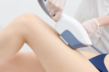 Medical procedure. Laser hair removal. Female feet. Bright skin