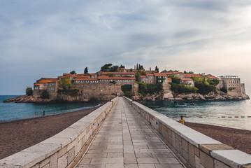 May, 29th, 2016 - Budva, Montenegro. Sveti Stefan island and beach near Budva, Montenegro on Adriatic coast. Wide angle view of Adriatic sea, private beach and bridge to St. Stefan luxury resort.