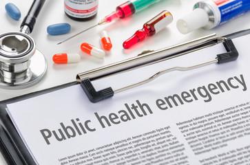 The text Public health emergency written on a clipboard