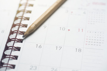 close up monthly planner and pencil, planning for business meeting or travel planning concept