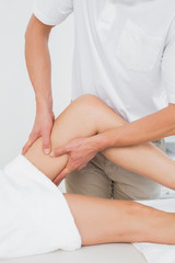 Male physiotherapist examining a womans leg