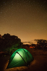 Tent lit with light in the wilderness of Utah, USA