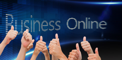 Group of hands giving thumbs up against business online on digital screen