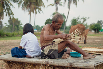 Grandfather and granddaughter at countryside.Living in rural Asia