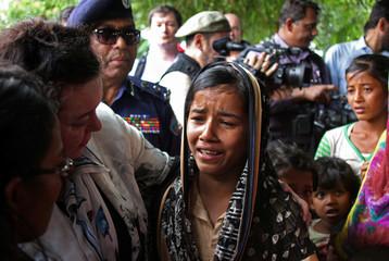 British United Nations Ambassador Karen Pierce consoles a twelve-year-old Rohingya refugee near Cox's Bazar, in Bangladesh