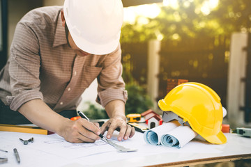 Engineer working with engineering tool on workplace