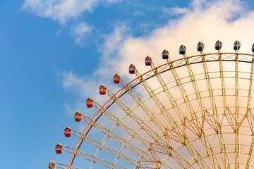 Fun fair amusement giant wheel with blue sky background