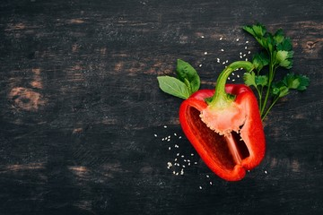 Fresh Bulgarian pepper. Paprika. On a wooden background. Top view. Copy space.