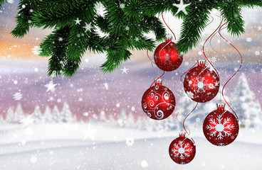 Composite image of christmas decorations against snowy landscape with fir trees