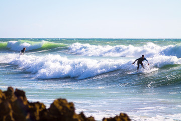 Surfer in the Atlantic Ocean. The coast of Agadir. Morocco
