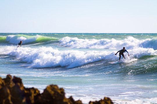 Surfer in the Atlantic Ocean. The coast of Agadir. Morocco
