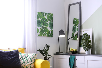 Stylish living room interior with large mirror. Idea for home decor