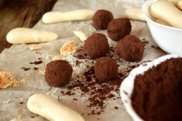 Chocolate truffles sprinkled with cocoa powder and meringues