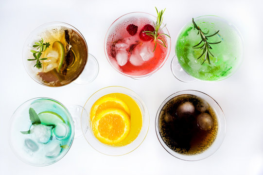 Colorful cocktails on white background