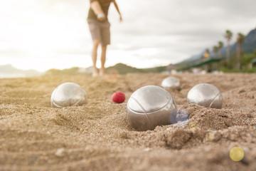 Beach. A game of Bocha. Brilliant silver balls for a bocha on the sand.