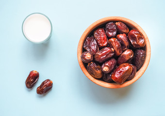 Sweet food for ramadan. Conceptual photo of Ramadan food:dates palm and milk.