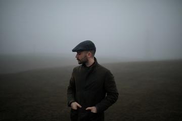Man in foggy field