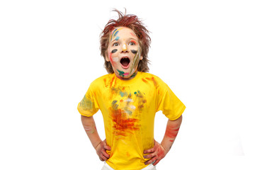 Young attractive amazed boy,with painted face and hands, vivid emotions, messy hair, yellow t-shirt